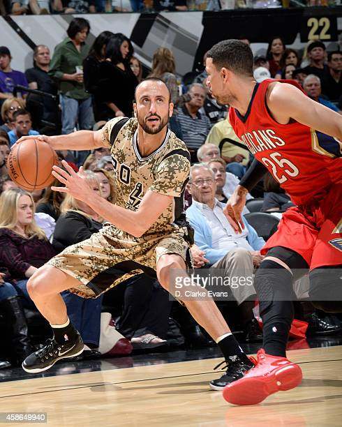 Manu Ginobili of the San Antonio Spurs handles the ball against the New Orleans Pelicans at the ATT Center on November 8 2014 in San Antonio Texas...