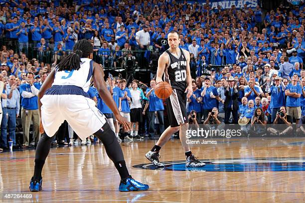 Manu Ginobili of the San Antonio Spurs handles the ball against the Dallas Mavericks in Game Four of the Western Conference Quarterfinals during the...