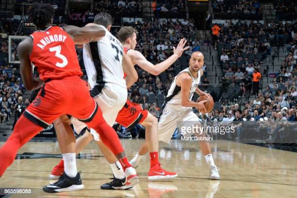 Manu Ginobili of the San Antonio Spurs handles the ball against the Toronto Raptors on October 23 2017 at the ATT Center in San Antonio Texas NOTE TO...