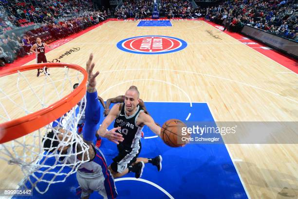 Manu Ginobili of the San Antonio Spurs handles the ball against the Detroit Pistons on December 30 2017 at Little Caesars Arena in Detroit Michigan...