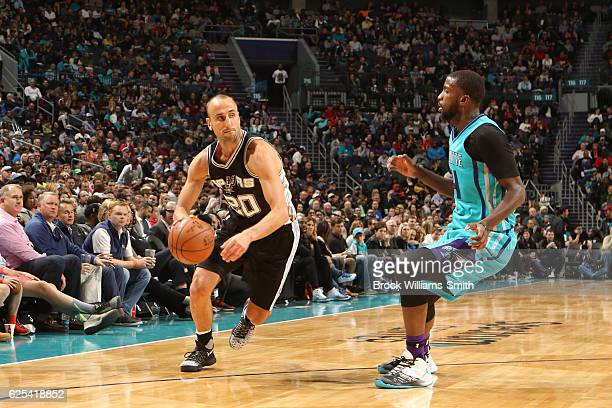 Manu Ginobili of the San Antonio Spurs handles the ball during a game against the Charlotte Hornets on November 23 2016 at the Spectrum Center in...
