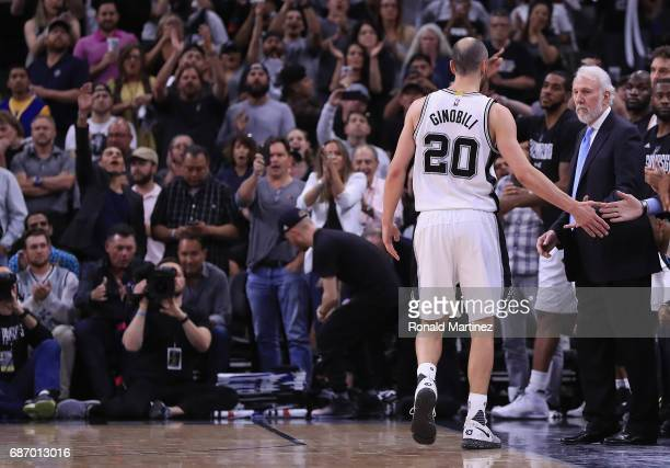 Manu Ginobili of the San Antonio Spurs high fives teammates in the second half against the Golden State Warriors during Game Four of the 2017 NBA...