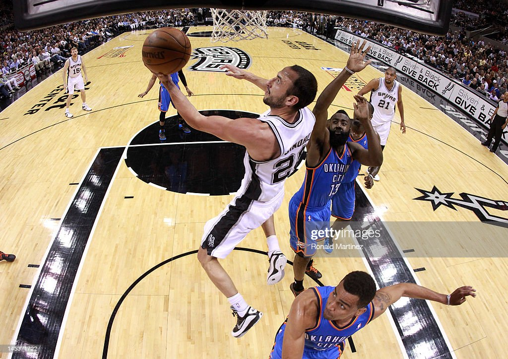 Manu Ginobili #20 of the San Antonio Spurs lays the ball up against Thabo Sefolosha #2 of the Oklahoma City Thunder in Game One of the Western Conference Finals of the 2012 NBA Playoffs at AT&T Center on May 27, 2012 in San Antonio, Texas.