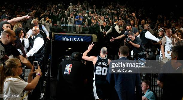 Manu Ginobili of the San Antonio Spurs leaves the court after a win against the Golden State Warriors in Game Four of Round One of the 2018 NBA...