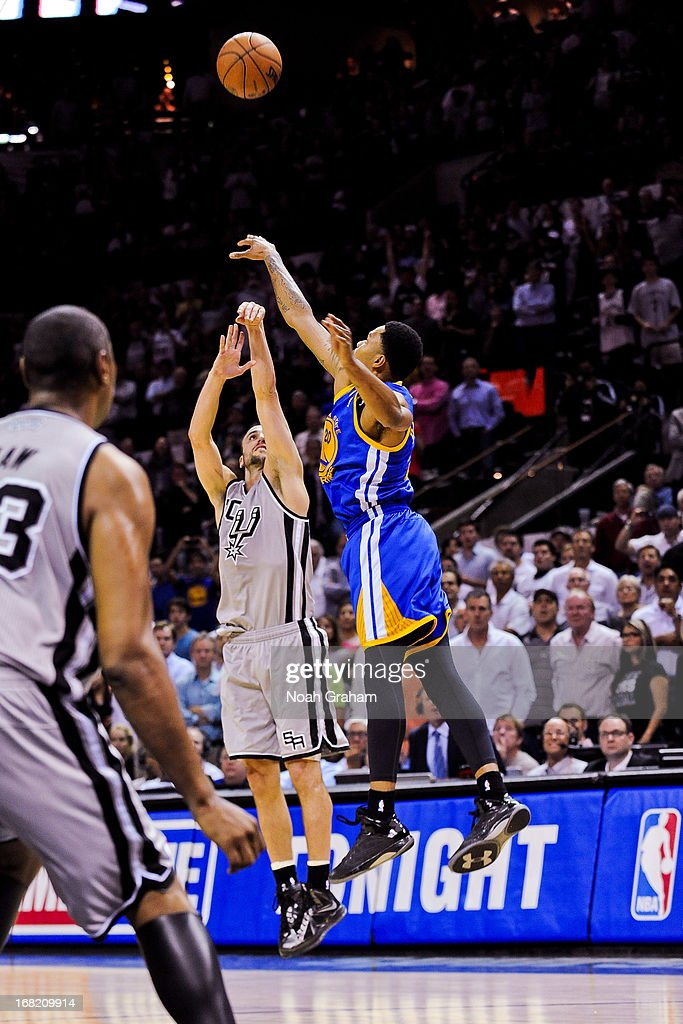 Manu Ginobili #20 of the San Antonio Spurs makes a go-ahead game-winning three-pointer against Kent Bazemore #20 of the Golden State Warriors in double overtime (2OT) in Game One of the Western Conference Semifinals during the 2013 NBA Playoffs on May 6, 2013 at the AT&T Center in San Antonio, Texas.