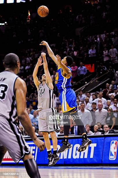 Manu Ginobili of the San Antonio Spurs makes a goahead gamewinning threepointer against Kent Bazemore of the Golden State Warriors in double overtime...