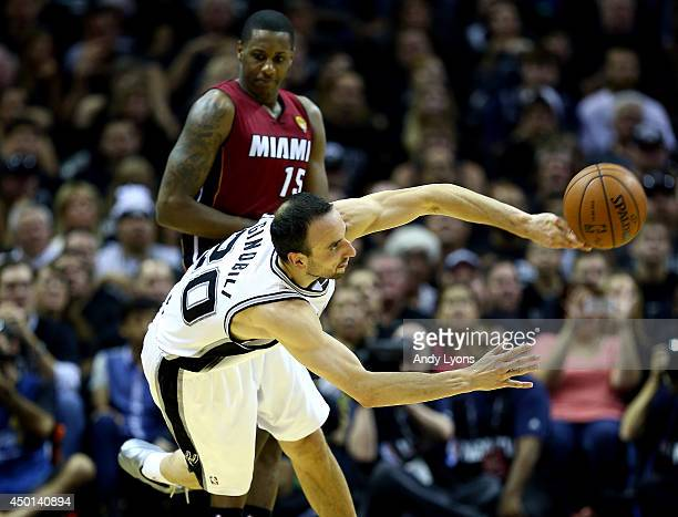 Manu Ginobili of the San Antonio Spurs makes a pass against the Miami Heat during Game One of the 2014 NBA Finals at the ATT Center on June 5 2014 in...