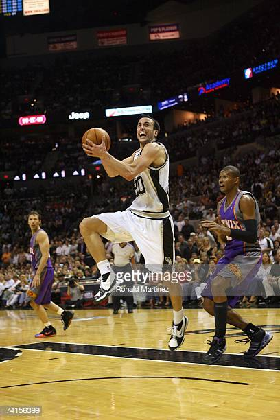 Manu Ginobili of the San Antonio Spurs moves past Leandro Barbosa of the Phoenix Suns in Game Four of the Western Conference Semifinals during the...