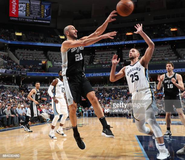 Manu Ginobili of the San Antonio Spurs passes the ball against Chandler Parsons of the Memphis Grizzlies on December 1 2017 at FedExForum in Memphis...