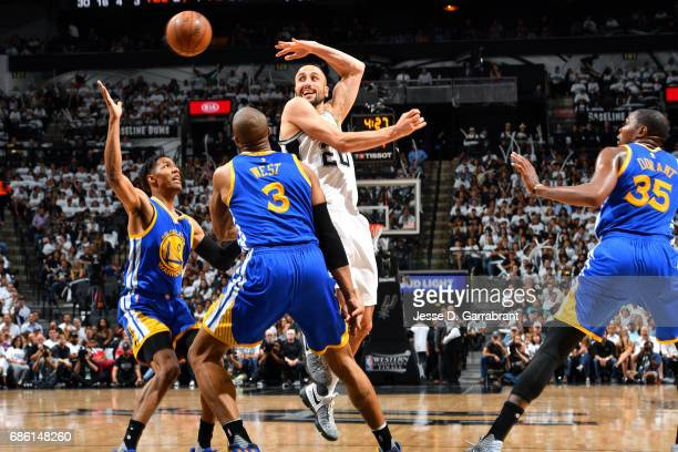 Manu Ginobili of the San Antonio Spurs passes the ball during the game against the Golden State Warriors during Game Three of the Western Conference...
