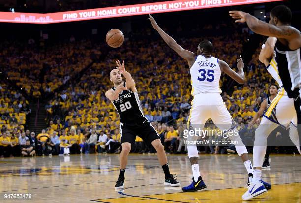 Manu Ginobili of the San Antonio Spurs passes the ball past the out stretched arm of Kevin Durant of the Golden State Warriors in the first quarter...