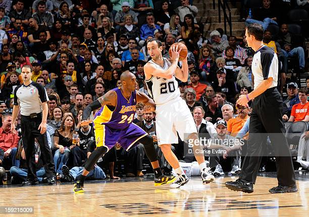 Manu Ginobili of the San Antonio Spurs protects the ball from Kobe Bryant of the Los Angeles Lakers during the game between the Los Angeles Lakers...