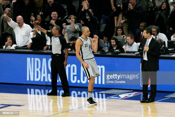 Manu Ginobili of the San Antonio Spurs reacts after scoring the game winning basket against the Boston Celtics on December 8 2017 at the ATT Center...