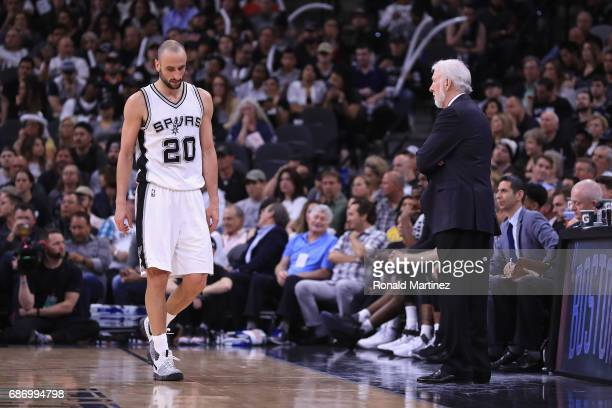 Manu Ginobili of the San Antonio Spurs reacts in the second half as head coach Gregg Popovich looks on during Game Four of the 2017 NBA Western...