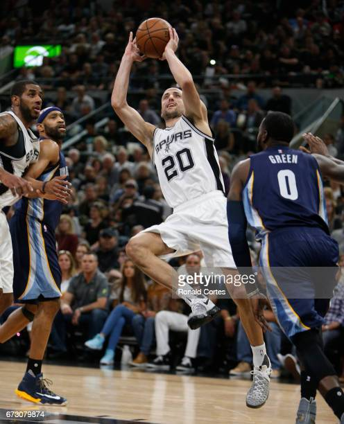 Manu Ginobili of the San Antonio Spurs scores against the Memphis Grizzlies in Game Five of the Western Conference Quarterfinals during the 2017 NBA...
