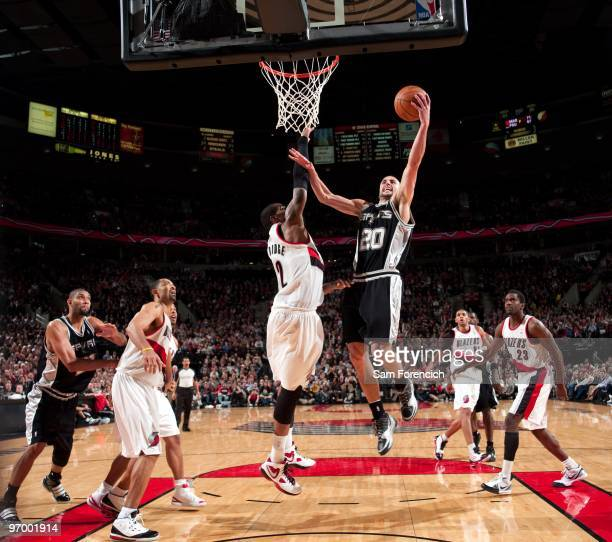 Manu Ginobili of the San Antonio Spurs shoots a layup against LaMarcus Aldridge of the Portland Trail Blazers during the game at The Rose Garden on...