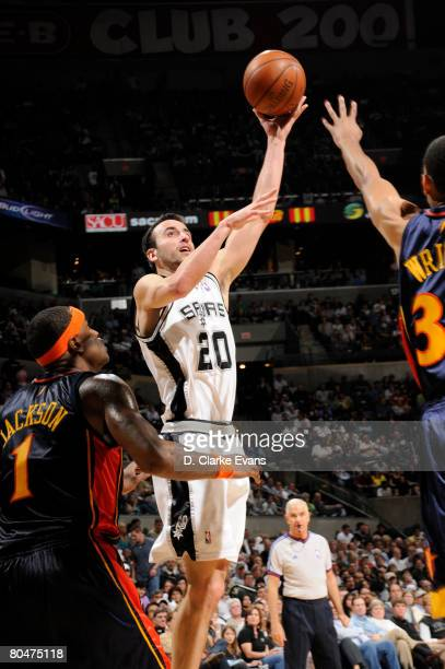 Manu Ginobili of the San Antonio Spurs shoots against Brandan Wright and Stephen Jackson of the Golden State Warriors on April 1 2008 at the ATT...