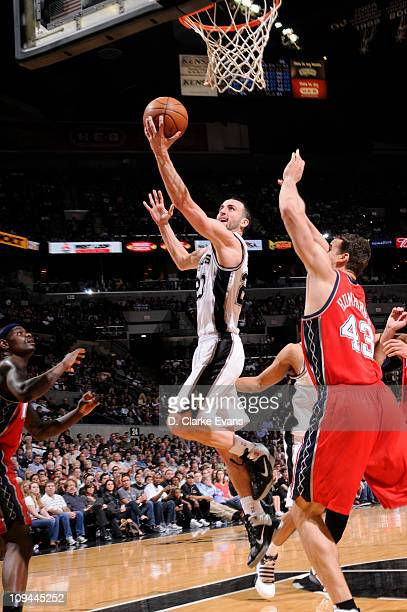 Manu Ginobili of the San Antonio Spurs shoots against Kris Humphries of the New Jersey Nets at ATT Center on February 25 2011 in San Antonio Texas...