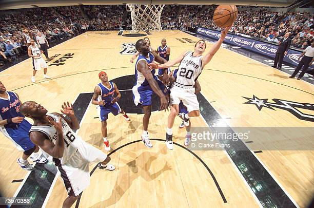 Manu Ginobili of the San Antonio Spurs shoots against Tim Thomas of the Los Angeles Clippers during the game at the ATT Center March 13 2007 in San...