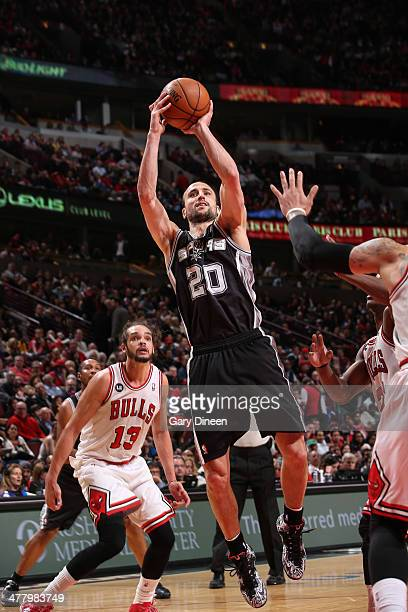Manu Ginobili of the San Antonio Spurs shoots as Joakim Noah of the Chicago Bulls watches from behind on March 11 2014 at the United Center in...