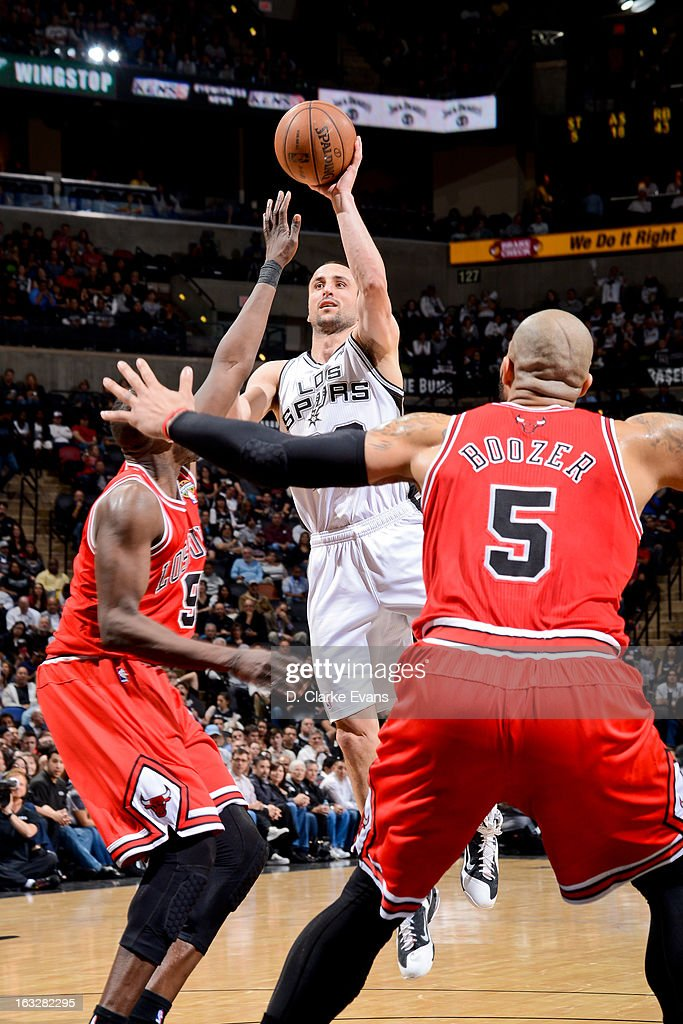 Manu Ginobili #20 of the San Antonio Spurs shoots in the lane against Luol Deng #9 of the Chicago Bulls on March 6, 2013 at the AT&T Center in San Antonio, Texas.