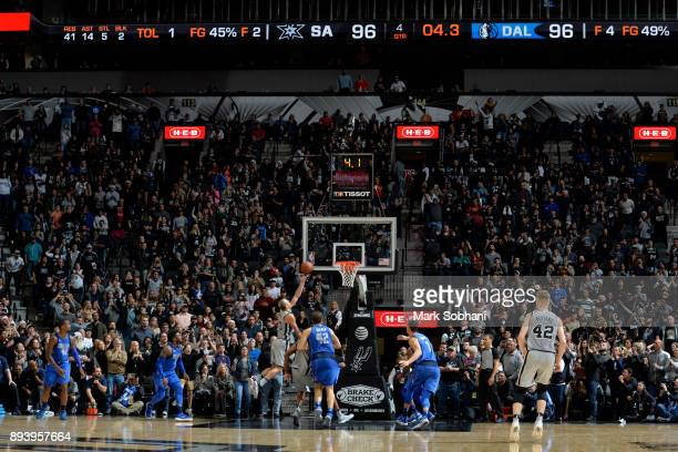Manu Ginobili of the San Antonio Spurs shoots the ball to win the game against the Dallas Mavericks on December 16 2017 at the ATT Center in San...