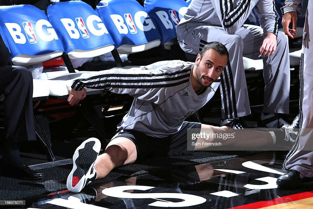 Manu Ginobili #20 of the San Antonio Spurs stretching before the game against the Portland Trail Blazers on December 13, 2012 at the Rose Garden Arena in Portland, Oregon.