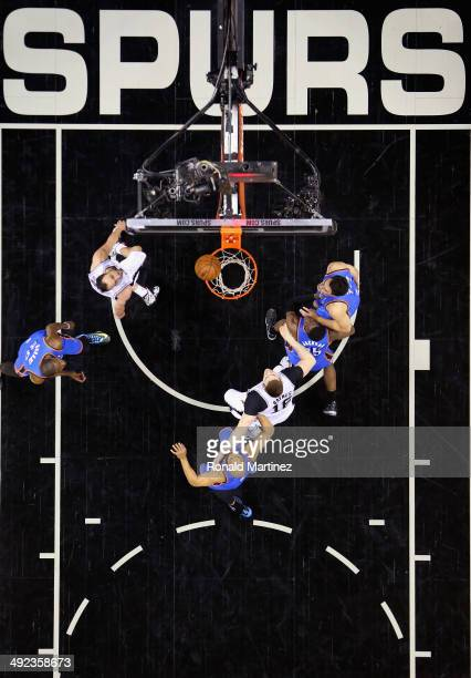 Manu Ginobili of the San Antonio Spurs takes a shot against the Oklahoma City Thunder in Game One of the Western Conference Finals during the 2014...