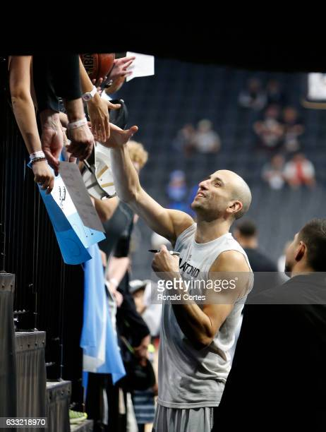 Manu Ginobili of the San Antonio Spurs takes time to greet fans before the start of their game against the Oklahoma City Thunder at ATT Center on...