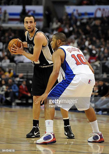 Manu Ginobili of the San Antonio Spurs waits to pass in front of Eric Gordon of the Los Angeles Clippers at Staples Center on December 13 2009 in Los...