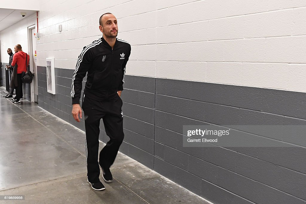 Manu Ginobili #20 of the San Antonio Spurs walks to the court before the game against the Sacramento Kings on October 27, 2016 at the Golden 1 Center in Sacramento, California.
