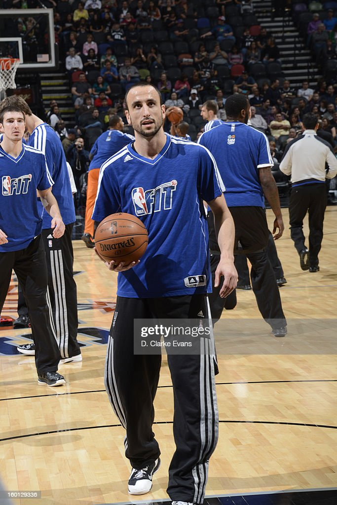 Manu Ginobili #20 of the San Antonio Spurs warms up, wearing a NBA Fit week shirt, before the game against the Phoenix Suns on January 26, 2013 at the AT&T Center in San Antonio, Texas.