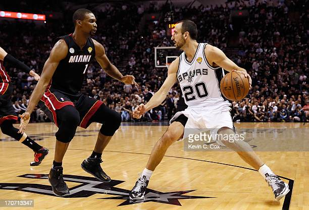 Manu Ginobili of the San Antonio Spurs with the ball against Chris Bosh of the Miami Heat in the first quarter during Game Five of the 2013 NBA...