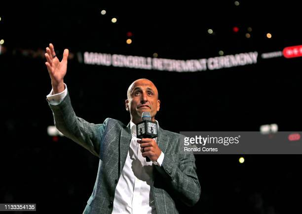Manu Ginobili talks to fans on his career where his number was retired in the background are two of the four championship trophies he won with the...