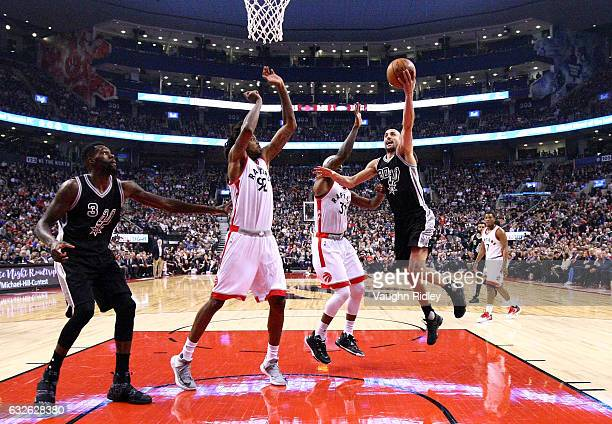 Manu Ginobli of the San Antonio Spurs shoots the ball during the first half of an NBA game against the Toronto Raptors at Air Canada Centre on...