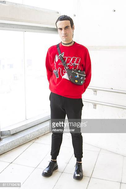 Manu Guillen wears Doctor Martens shoes Maria Escote Jersey Cos pants and Moschino fanny during Mercedes Benz Fashion Week at Ifema on February 19...