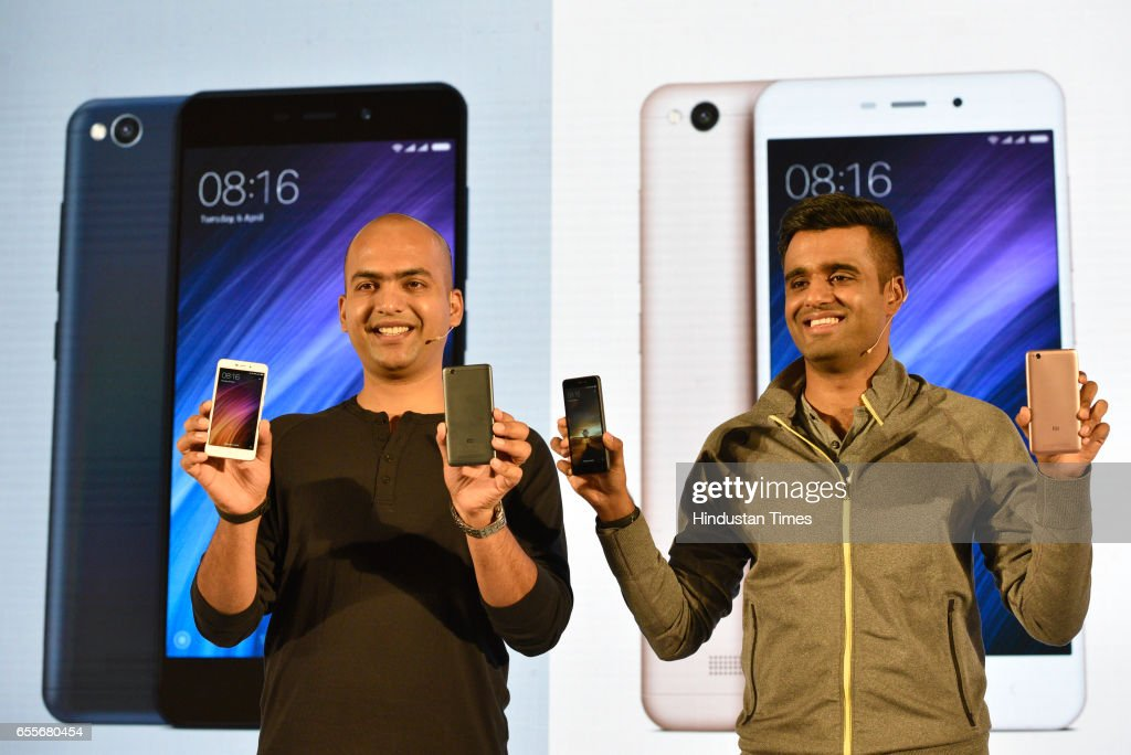 Manu Jain, Vice President and Managing Director, Xiomi India and Jai Mani, Product Lead, Xiomi India, pose with Xiomi Redmi 4A during its launch on March 20, 2017 in New Delhi, India.