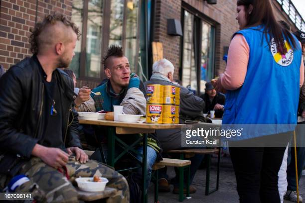 Manu K a punk chats with an assistant during a street fest for homeless people held by the Bahnhofsmission homeless kitchen on April 20 2013 in...