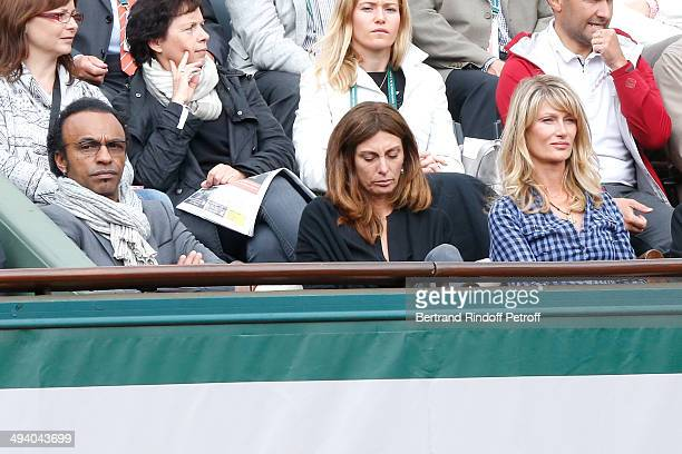 Manu Katche his wife Laurence Katche and producer Isabelle Camus attend the Roland Garros French Tennis Open 2014 Day 3 on May 27 2014 in Paris France