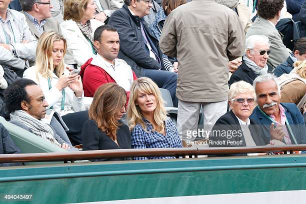 Manu Katche his wife Laurence Katche producer Isabelle Camus former tennis player Mansour Bahrami and his wife Veronique attend the Roland Garros...