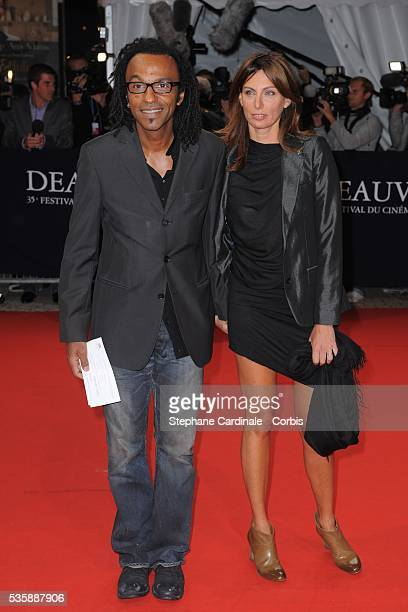 Manu Katche with his wife Laurence Katche arrive at the screening of American director Nora Ephron's film 'Julie and Julia' at the 35th Deauville...