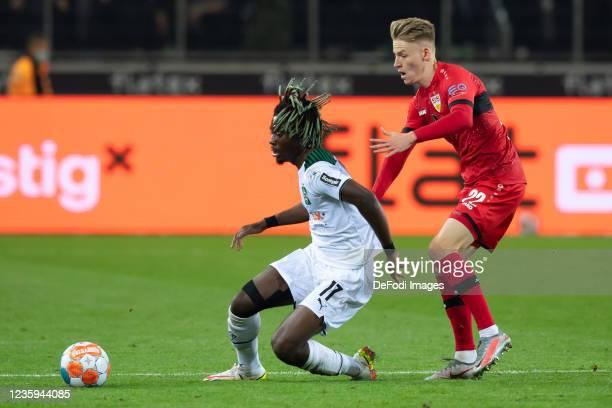 Manu Kone of Borussia Moenchengladbach and Chris Fuehrich of VfB Stuttgart battle for the ball during the Bundesliga match between Borussia...