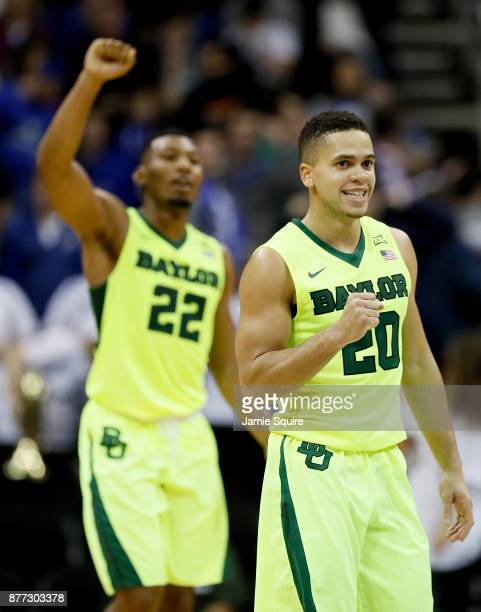 Manu Lecomte and King McClure of the Baylor Bears celebrate as the Bears defeated the Creighton Bluejays to win he National Collegiate Basketball...
