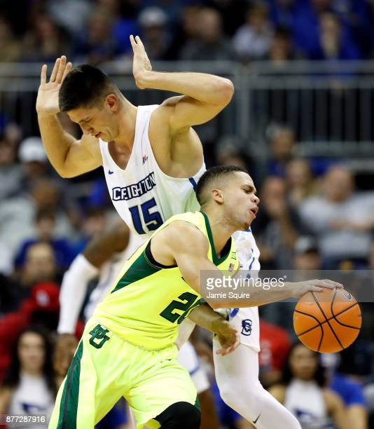 Manu Lecomte of the Baylor Bears drives as Martin Krampelj of the Creighton Bluejays defends during the National Collegiate Basketball Hall Of Fame...