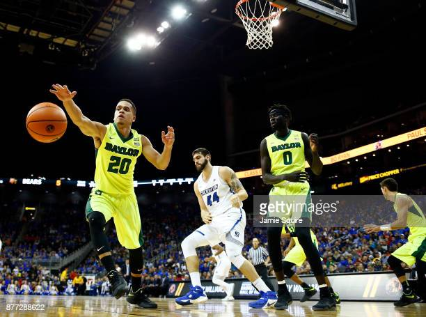 Manu Lecomte of the Baylor Bears lunges for a loose ball during the National Collegiate Basketball Hall Of Fame Classic Championship game against the...