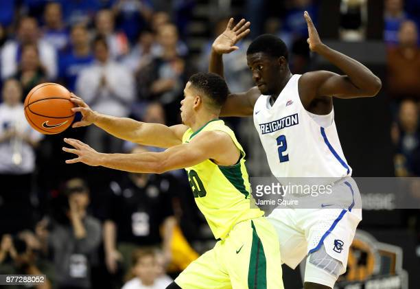 Manu Lecomte of the Baylor Bears passes as Khyri Thomas of the Creighton Bluejays defends during the National Collegiate Basketball Hall Of Fame...