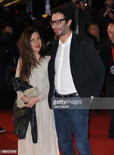 Manu Levy and his wife Alina Schiau arrive at the16th NRJ Music Awards held at the Palais des Festivals on the Croisette Avenue on December 13 2014...
