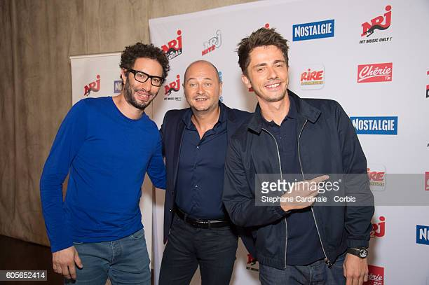 Manu Levy Sebastien Cauet and Guillaume Pley pose at the Photocall of NRJ Group at Musee du Quai Branly on September 14 2016 in Paris France