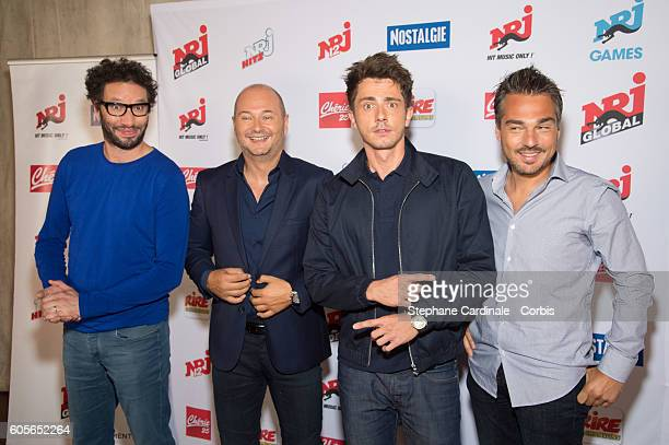 Manu Levy Sebastien Cauet Guillaume Pley and MIKL pose at the Photocall of NRJ Group at Musee du Quai Branly on September 14 2016 in Paris France