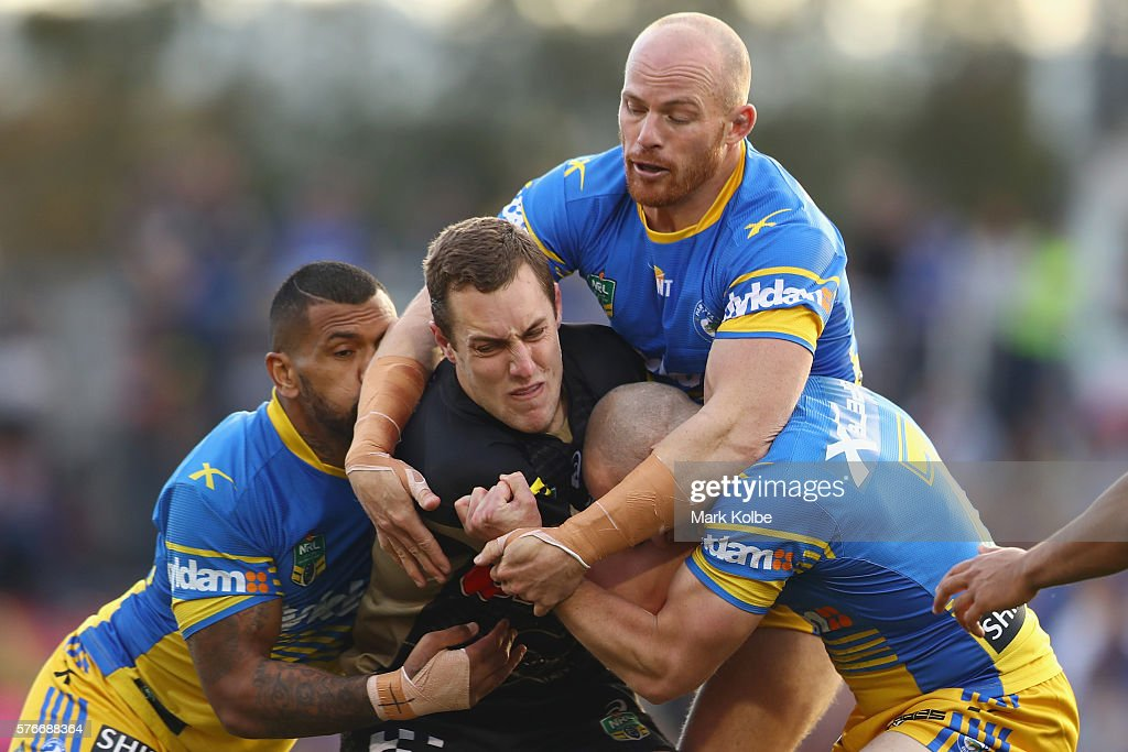 Manu Ma'u, Beau Scott and Jeff Robson of the Eels tackle Isaah Yeo of the Panthers during the round 19 NRL match between the Penrith Panthers and the Parramatta Eels at Pepper Stadium on July 17, 2016 in Sydney, Australia.